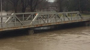 Water approaches the bridge heading into downtown London near Harris Park. (Celine Moreau / CTV London)