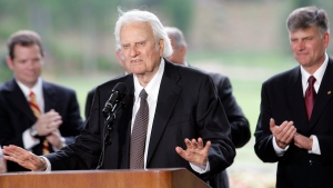 In this May 31, 2007 file photo, Billy Graham speaks as his son Franklin Graham, right, listens during a dedication ceremony for the Billy Graham Library in Charlotte, N.C. (AP Photo/Gerry Broome)