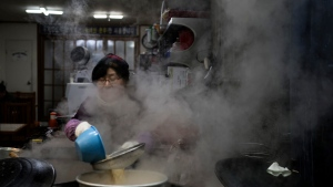 A woman cooks at a restaurant in Gangneung, South Korea, Monday, Feb. 12, 2018. Korean food is some of the world's finest - savory, salty soups with fish so tender it falls off the bone; thick slabs of grilled pork and beef backed with spicy kimchi that many Korean grandmothers swear cures the common cold. (AP / Felipe Dana)
