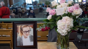 A photograph and a floral arrangement sit in the reception area at the funeral for Rebecca Schofield at Immaculate Heart of Mary Catholic Church in Riverview, N.B. on Wednesday, Feb. 21, 2018. (THE CANADIAN PRESS/Andrew Vaughan)