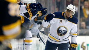 In this Feb. 10, 2018, file photo, Buffalo Sabres' Evander Kane (9) celebrates his goal during the second period of an NHL hockey game against the Boston Bruins, in Boston.  (AP Photo/Michael Dwyer, File)