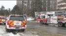 Fire vehicles idle outside a working fire on Riverside Drive.