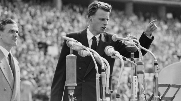 FILE - In this June 27, 1954 file photo, Evangelist Billy Graham speaks to over 100,000 Berliners at the Olympic Stadium in Berlin, Germany. (AP Photo)