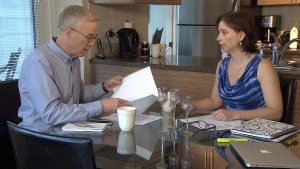 Kelly Hayes shows Ross McLaughlin the Empty Homes Tax forms she filled out with the city. (CTV)