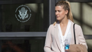 Tennis star Eugenie Bouchard leaves Brooklyn Federal court, Wednesday, Feb. 21, 2018, in New York. Bouchard testified during her negligence lawsuit against the United States Tennis Association that a wet floor caused her to slip and fall inside a locker room at the 2015 U.S. Open. (AP Photo / Mary Altaffer)