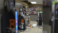 RCMP released a photo showing damage inside the Penhold Fas Gas - Jordan Bell-Blowers, 21, is facing a number of charges after he was found in the ceiling of the gas station early Monday, February 19, 2018.
