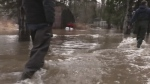 High waters flood roads, properties