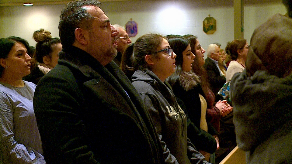 Kaesir Istifo, a member of Saskatoon's Chaldean community, attends a service in the city.