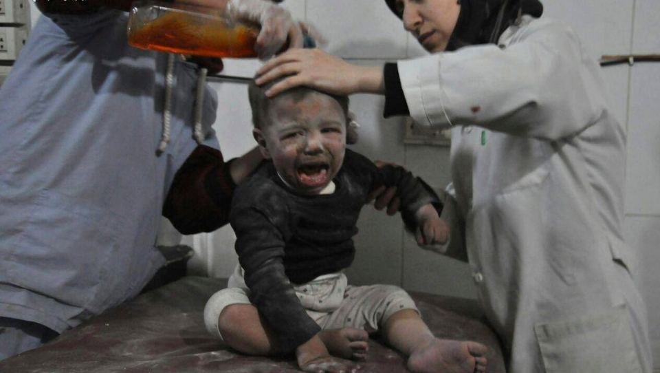 In this photo released on Wednesday Feb. 21, 2018, provided by the Syrian anti-government activist group Ghouta Media Center, which has been authenticated based on its contents and other AP reporting, shows Syrian paramedics treat a kids who was wounded during airstrikes and shelling by Syrian government forces, at a makeshift hospital, in Ghouta, suburb of Damascus, Syria. (Ghouta Media Center via AP)