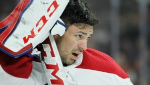 After going down hard on the ice Montreal Canadiens goalie Carey Price takes off his face mask and waits for the team trainer during the second period of an NHL hockey game Tuesday, Feb. 20, 2018 in Philadelphia. T(AP Photo/Tom Mihalek)