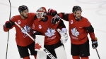 Canada goaltender Kevin Poulin (31), defenceman Marc-Andre Gragnani (18)and forward Rene Bourque (17) celebrate defeating Finland in the Olympic quarterfinal hockey action at the 2018 Olympic Winter Games in Pyeongchang, South Korea on Wednesday, February 21, 2018. (THE CANADIAN PRESS/Nathan Denette)