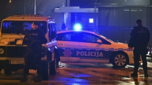Police block off the area around the U.S. Embassy in Montenegro's capital Podgorica, Thursday, Feb. 22, 2018. (AP Photo/Risto Bozovic)