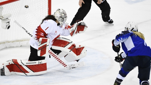 Monique Lamoureux scores against Canada at the 2018 Winter Olympics in Gangneung, South Korea, Thursday, Feb. 22, 2018. (AP Photo/David J. Phillip )