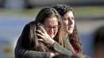 Students released from a lockdown embrace following following a shooting at Marjory Stoneman Douglas High School in Parkland, Fla. on Wednesday, Feb. 14, 2018. (John McCall/South Florida Sun-Sentinel)