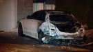 One of the two cars set on fire on Carré Stewart in St. Laurent (CTV Montreal/Cosmo Santamaria)