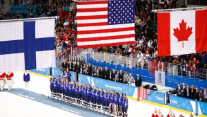 Members of the United States hockey team pose with their gold medals after beating Canada in the women's gold medal hockey game at the 2018 Winter Olympics in Gangneung, South Korea, Thursday, Feb. 22, 2018. (AP / Jae C. Hong)