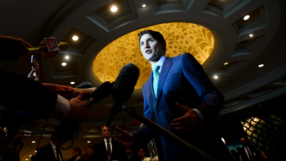 Prime Minister Justin Trudeau stops to speak to media as he arrives to the India Canada Business Session in New Delhi, India on Thursday, Feb. 22, 2018. (THE CANADIAN PRESS/Sean Kilpatrick)