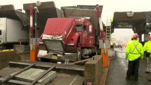 Truck crashes into Halifax toll booth