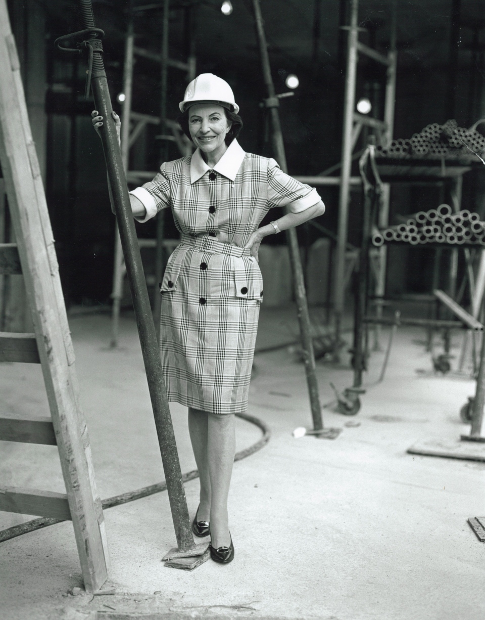 Sonja Bata pose as she tours an Alcan plant in this undated handout photo. (Bata Shoe Museum)