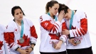 Canada defenceman Lauriane Rougeau (5) comforts forward Rebecca Johnston (6) after losing to the United States in shootout women's gold medal final Olympic hockey action at the 2018 Olympic Winter Games in Gangneung, South Korea on Thursday, February 22, 2018.  THE CANADIAN PRESS/Nathan Denette
