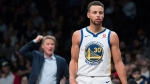 In this Nov. 19, 2017, photo, Golden State Warriors guard Stephen Curry stands on the court as coach Steve Kerr gestures during the second half of the team's NBA basketball game against the Brooklyn Nets in New York. (AP /Mary Altaffer,)