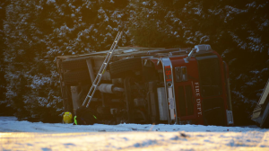 A fire truck rolled over into a ditch at the bottom of an icy hill in Langley Township Thursday.