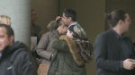 Bernard Biron hugs his wife following the guilty verdict for the man whose dogs attacked their daughter (Feb. 22, 2018)