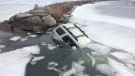 A SUV went through the ice on Lake Simcoe in the Jacksons Point, Ont. area on Thursday, Feb. 22, 2018. (Mike Walker/ CTV Barrie)