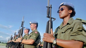 Canadian Peacekeepers prepare for a parade at Maple Leaf Camp in Port-au-Prince on Nov. 28,1997. Canada is looking at ways to help other countries boost the number of female peacekeepers, despite having only a handful of Canadian women in blue helmets and berets. THE CANADIAN PRESS/AP, Daniel Morel
