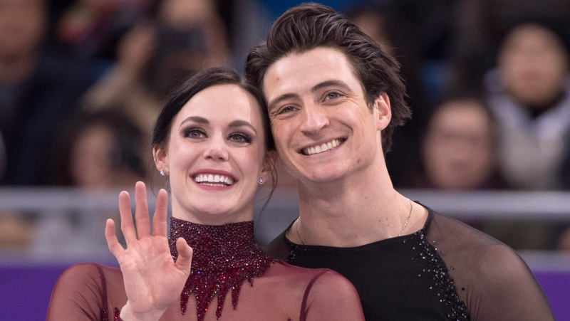 Ice dance gold medalists Canada's Tessa Virtue and Scott Moir look up to the crowd during victory ceremonies at the Pyeongchang Winter Olympics Feb. 20, 2018 in Gangneung, South Korea. THE CANADIAN PRESS/Paul Chiasson