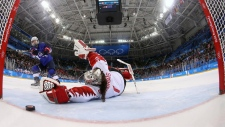 Jocelyne Lamoureux-Davidson (17), of the United States, scores a game winning goal against goalie Shannon Szabados (1), of Canada, in the penalty shootout during the women's gold medal hockey game at the 2018 Winter Olympics in Gangneung, South Korea, Thursday, Feb. 22, 2018. (Bruce Bennett / Pool Photo via AP)
