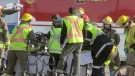 Firefighters and paramedics work at the scene of a serious collision on Farmers Market Road near Waterloo on Thursday, Feb. 22, 2018.