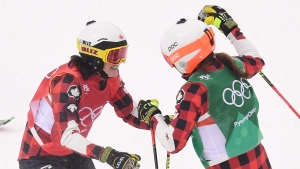 Canadians Kelsey Serwa, left, and Brittany Phelan celebrate following the women's ski cross semifinal at the Phoenix Snow Park at the 2018 Winter Olympic Games in Pyeongchang, South Korea, Friday, Feb. 23, 2018. THE CANADIAN PRESS/Jonathan Hayward