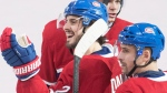 Montreal Canadiens' Phillip Danault (24) celebrates with teammate Tomas Plekanec after scoring an empty net goal against the New York Rangers during third period NHL hockey action in Montreal, Thursday, February 22, 2018. THE CANADIAN PRESS/Graham Hughes