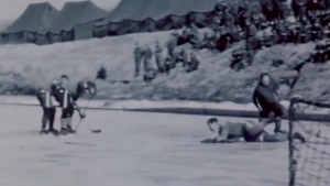 Canadian soldiers play hockey during a rest from fighting in the Korean War.