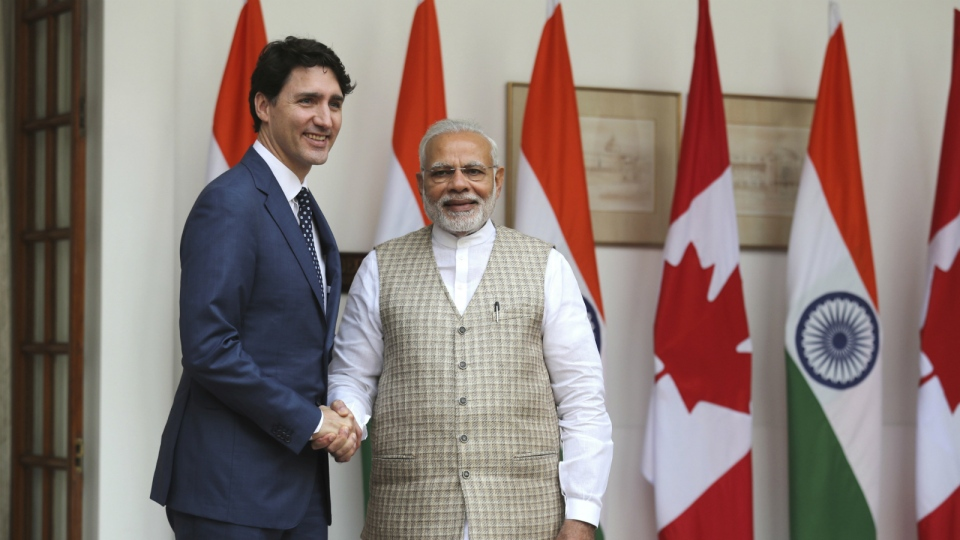 Indian Prime Minister Narendra Modi, right, shakes hand with his Canadian counterpart Justin Trudeau before their meeting in New Delhi, India, Friday, Feb. 23, 2018. (AP Photo/Manish Swarup)
