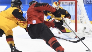 Canada forward Derek Roy (9) cuts towards the net during first period semifinal Olympic men's hockey action against Germany, on Feb. 23, 2018. (Nathan Denette / THE CANADIAN PRESS)