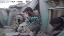 Child rescued from Syrian building as violence rag