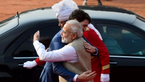 Prime Minister Justin Trudeau is greeted by Prime Minister of India Narendra Modi as he arrives for an official welcoming ceremony at the Presidential Palace in New Delhi, India on Friday, Feb. 23, 2018. (THE CANADIAN PRESS/Sean Kilpatrick)