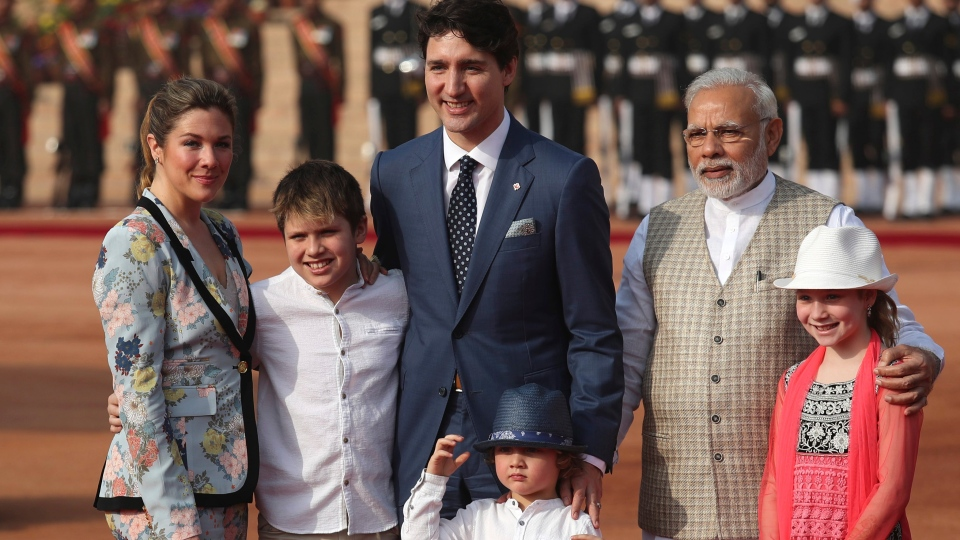 Indian Prime Minister Narendra Modi, second right, poses for the photographers with his Canadian counterpart Justin Trudeau and his family, wife Sophie Gregoire Trudeau, left, sons Xavier and Hadrien, daughter Ella-Grace upon their arrival at the Indian presidential palace during a ceremonial reception, in New Delhi, India, Friday, Feb. 23, 2018. (AP Photo/Manish Swarup)