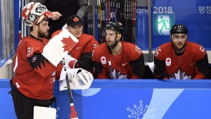 Canada goaltender Kevin Poulin (31) stands at the bench during third period semifinal Olympic men's hockey action against Germany, on Feb. 23, 2018. (Nathan Denette / THE CANADIAN PRESS)