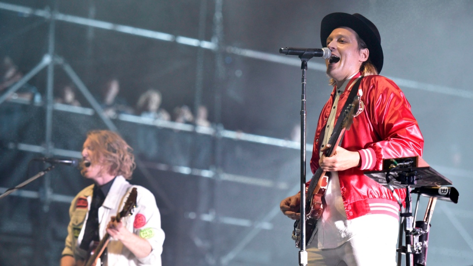 Richard Reed Parry and Win Butler of Arcade Fire perform on Day 4 at Lollapalooza in Grant Park in Chicago on August 6, 2017. THE CANADIAN PRESS/AP, Invision, Rob Grabowski