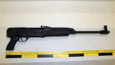 A semi-automatic rifle has been seized and a 24-year-old man has been charged as part of an anti-gang investigation. (Ottawa Police)
