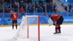 Chay Genoway (5) and Rene Bourque (17), of Canada, skate off after the semifinal round of the men's hockey game against Germany at the 2018 Winter Olympics in Gangneung, South Korea, Friday, Feb. 23, 2018. Germany won 4-3. (AP Photo/Matt Slocum)
