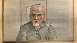 Accused killer Bruce McArthur appears via video link in a Toronto courtroom to face a sixth charge of first-degree murder on Feb. 23, 2018. (Sketch by John Mantha)