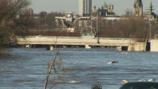 The Grand River runs high along Highway 24 in the south end of Cambridge on Thursday, Feb. 22, 2018.