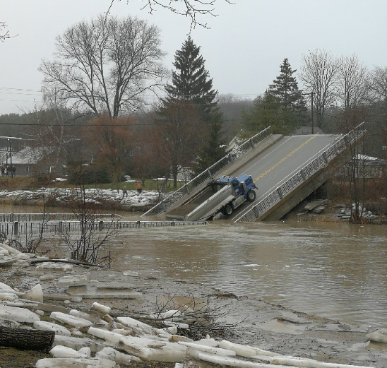 Witnesses said the bridge broke in the middle and created five-foot waves when a portion fell into the water below around 12 p.m.