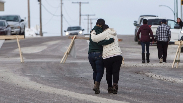 Family and supporters hug as they leave a La Loche, Sask., court following a judge's decision to sentence the La Loche shooter as an adult Friday, Feb. 23, 2018. THE CANADIAN PRESS/Jason Franson