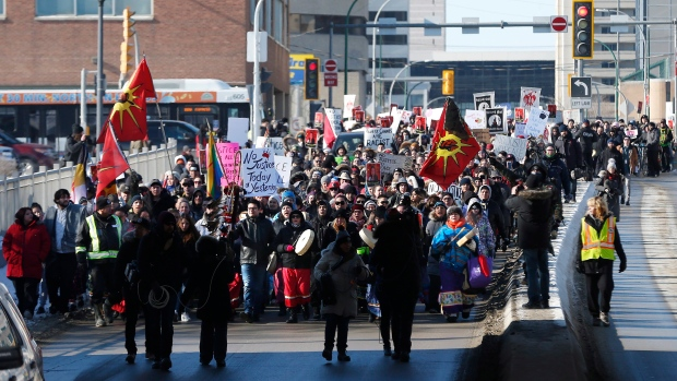 Family and supporters of Thelma Favel, Tina Fontaine's great-aunt and the woman who raised her, marched today, Friday, February 23, 2018, in Winnipeg the day after the jury delivered a not-guilty verdict in the 2nd degree murder trial of Raymond Cormier. THE CANADIAN PRESS/John Woods