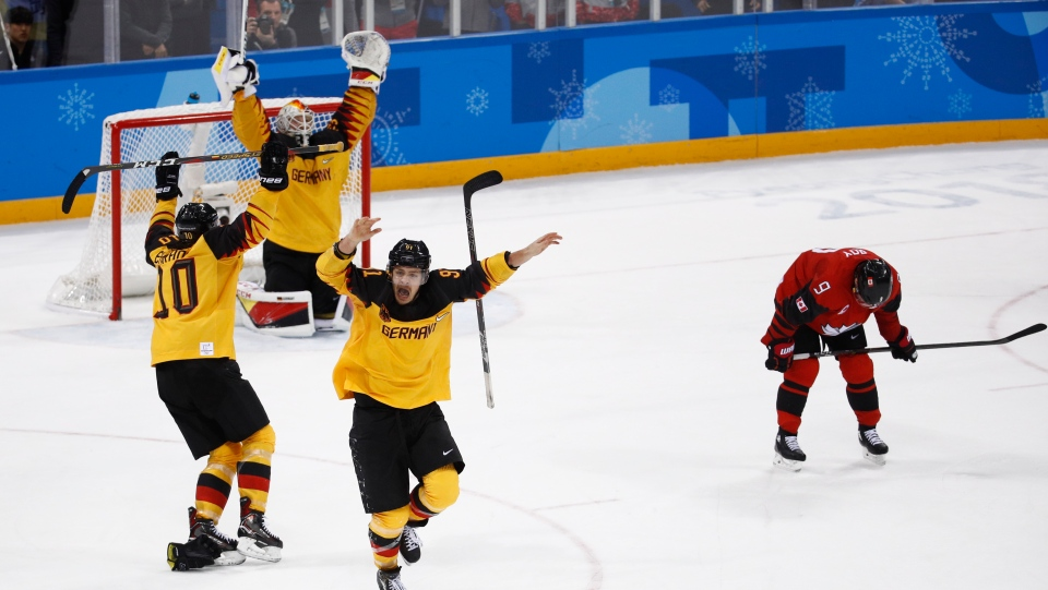 Germany players celebrate after the semifinal round of the men's hockey game against Canada at the 2018 Winter Olympics in Gangneung, South Korea, Friday, Feb. 23, 2018. Germany won 4-3. (AP Photo/Patrick Semansky)